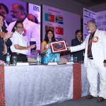 Arvind Sinha honouring Dr. Kavita gupta with Memento