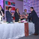 D.R. Mehta honouring Dr. G.D. Yadav with Memento