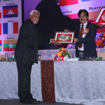 Dr. Chandan Chatterjee receiving the Memento on behalf of Ms Mamta Verma by T.L. Patel