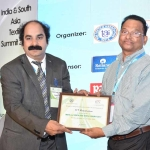Dr. Hemant Sonare offering the participation certificate to Mr. K.T. Ramakrishnan