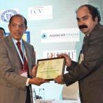 Dr. Hemant Sonare offering the participation certificate to Mr. Pradeep Mukherjee