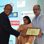 Dr. M.D. Teli offering the participation certificate to Mr. Varun Singhi