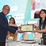 Dr. M.D. Teli offering the participation certificate to Ms Rakhi Vashisht