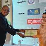 Dr. M.D. Teli offering the participation certificate to Ms. Chandrima Chatterjee