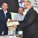 Mr. Arvind Sinha offering the participation certificate to Mr. Atul  Ujagar