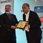 Mr. Arvind Sinha offering the participation certificate to Mr. R.D. Udeshi