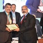 Mr. Arvind Sinha offering the participation certificate to Mr. Shailesh Maritus