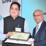 Mr. D.R. Mehta offering the participation certificate to Mr. Avinash Mayekar