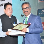 Mr. D.R. Mehta offering the participation certificate to Mr. Faruque Hassan