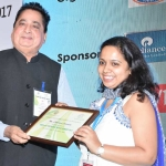 Mr. D.R. Mehta offering the participation certificate to Ms. Chandrima Chatterjee