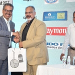 Mr. Faruque Hassan offering a gift to Mr. Arvind Sinha