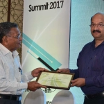 Mr. H.N. Jain offering the participation certificate to Mr. Arvind Bhansali