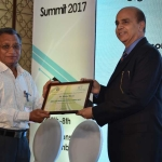 Mr. H.N. Jain offering the participation certificate to Mr. Sanjay Muthal