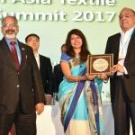 Mr. R.D. Udeshi felicicating by hand of Dr. Kavita Gupta