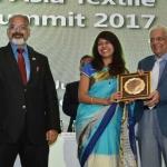 Mr. Suresh Kotak felicicating by hand of Dr. Kavita Gupta
