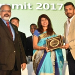 Mr. Vidyut Acharya felicicating by hand of Dr. Kavita Gupta