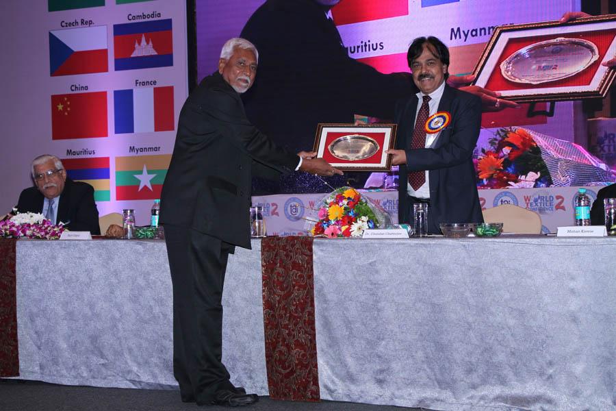 Dr. Chandan Chatterjee receiving the Memento on behalf of Ms Mamta Verma by T.L. Patel
